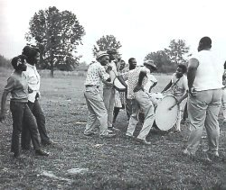 Mississippi Hill Country showing Napoleon Strickland on fife, Jimmy Buford on bass, drum, R L Boyce on snare drum and Othar Turner dancing