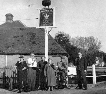 Group outside HH Inn, Cheriton, Hants.  Bob and Joan Copper, centre.