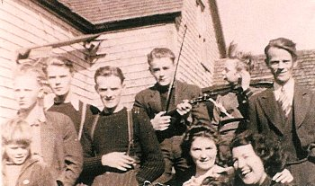 The MacDonald family in 1942. Lila MacIsaac in lower right; John holds the fiddle