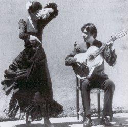 Tomás de los Reyes in action with dancer, María Gómez.