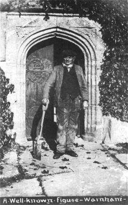 Michael Turner at the church door of Warnham Church - this time in more conventional gravedigger's attire.  His status seems to be indicated by this postcard which, together with the one of his gravestone, appear to have been produced for commercial sale.
