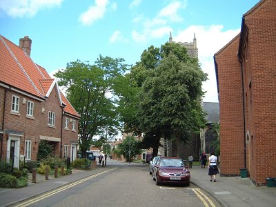 Photo 5. The lower, southern, end of Coslany Street, looking north and showing St Michael's (St Miles') church partially obscured by the tree in the photograph and the probable site of Walker's premises - where the White Hart pub stood - just before the corner of the block of flats on the right (Howard Marshall, June 2008